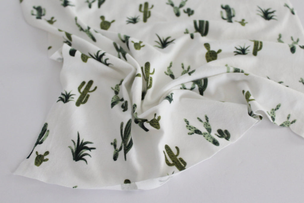 End of Bolt: 4 yards of Double Brushed Poly Spandex Ivory and Green Cacti Knit