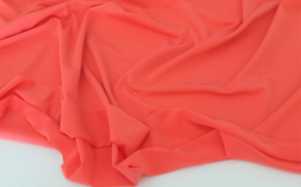End of Bolt: 3-1/8th yards of Coral ITY Jersey Knit Solid