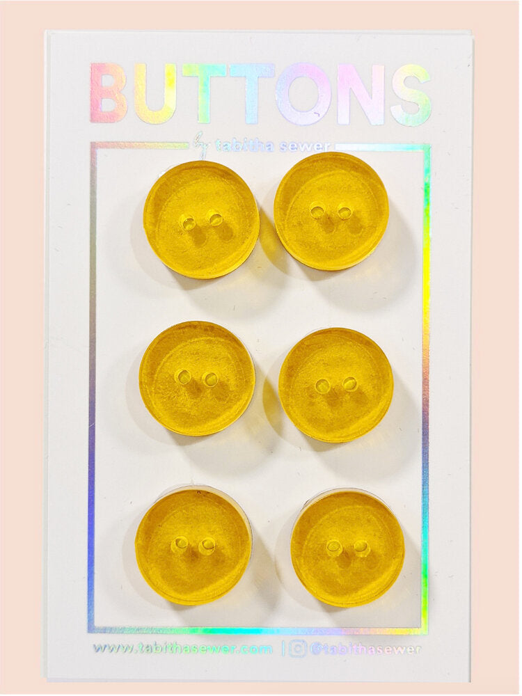 Notions: Lemon Transparent Circle Button- .59 in- Pack of 6 Buttons