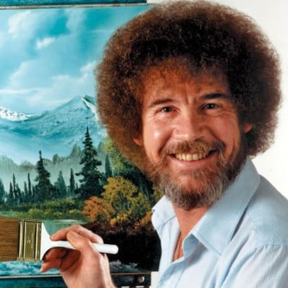 painter bob ross posing with painting