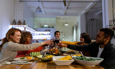 group of friends having thanksgiving dinner