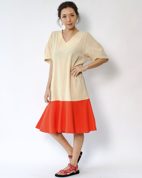 beige with bright orange V neck frill dress