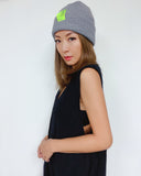 grey knitted beanie hat with neon green tap