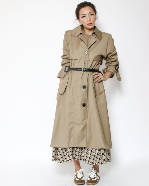 beige trench coat with leather belt