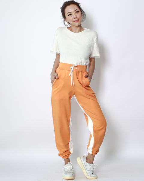 orange with ivory panel sweat joggers