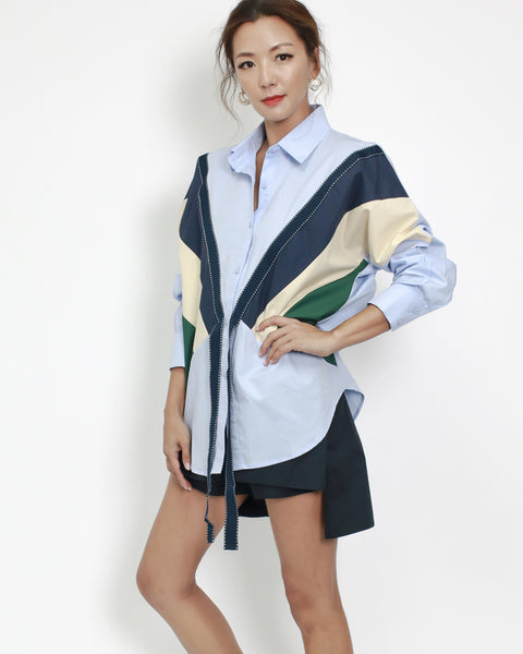 blue shirt with navy & green contrast top