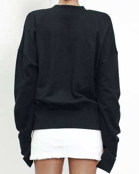black sweatshirt with pearls