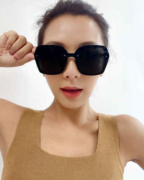 black with dark grey lens frameless sunglasses