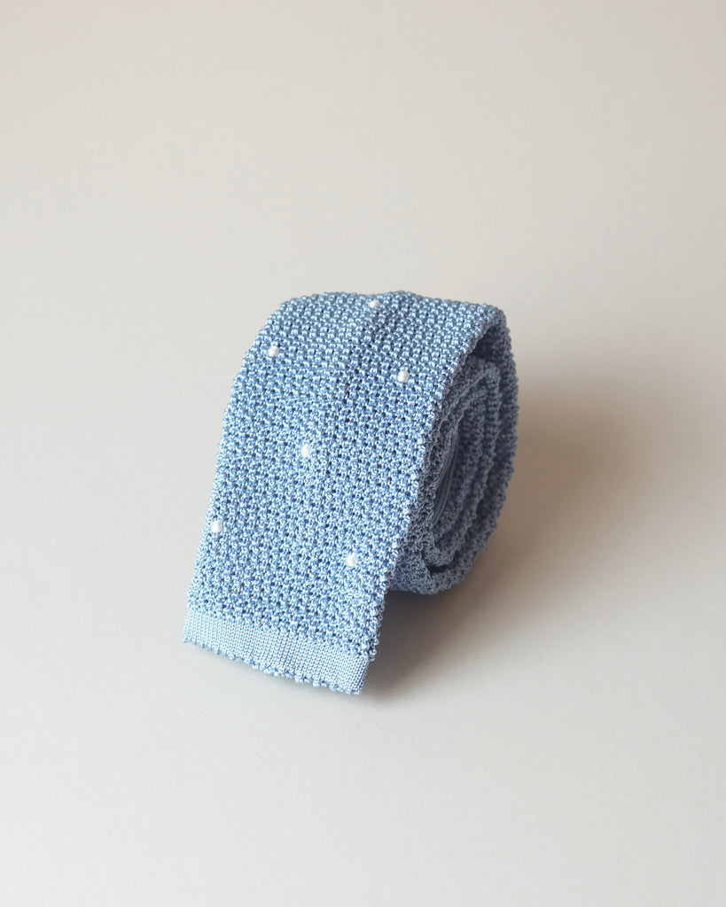Sky blue knit tie with handsewn white spots
