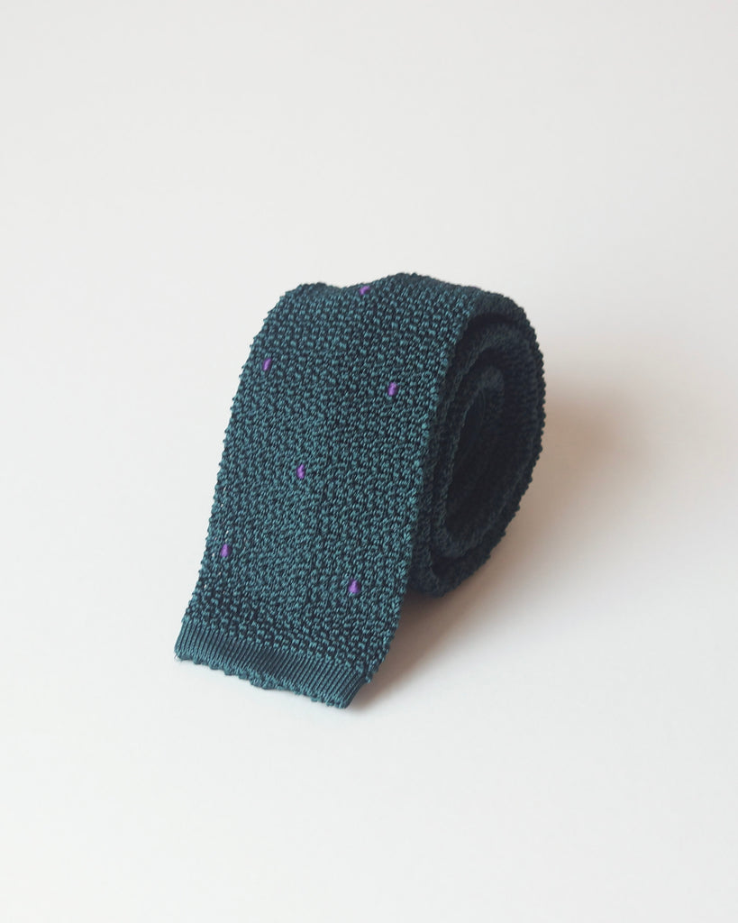 Green knit tie with handsewn purple spots
