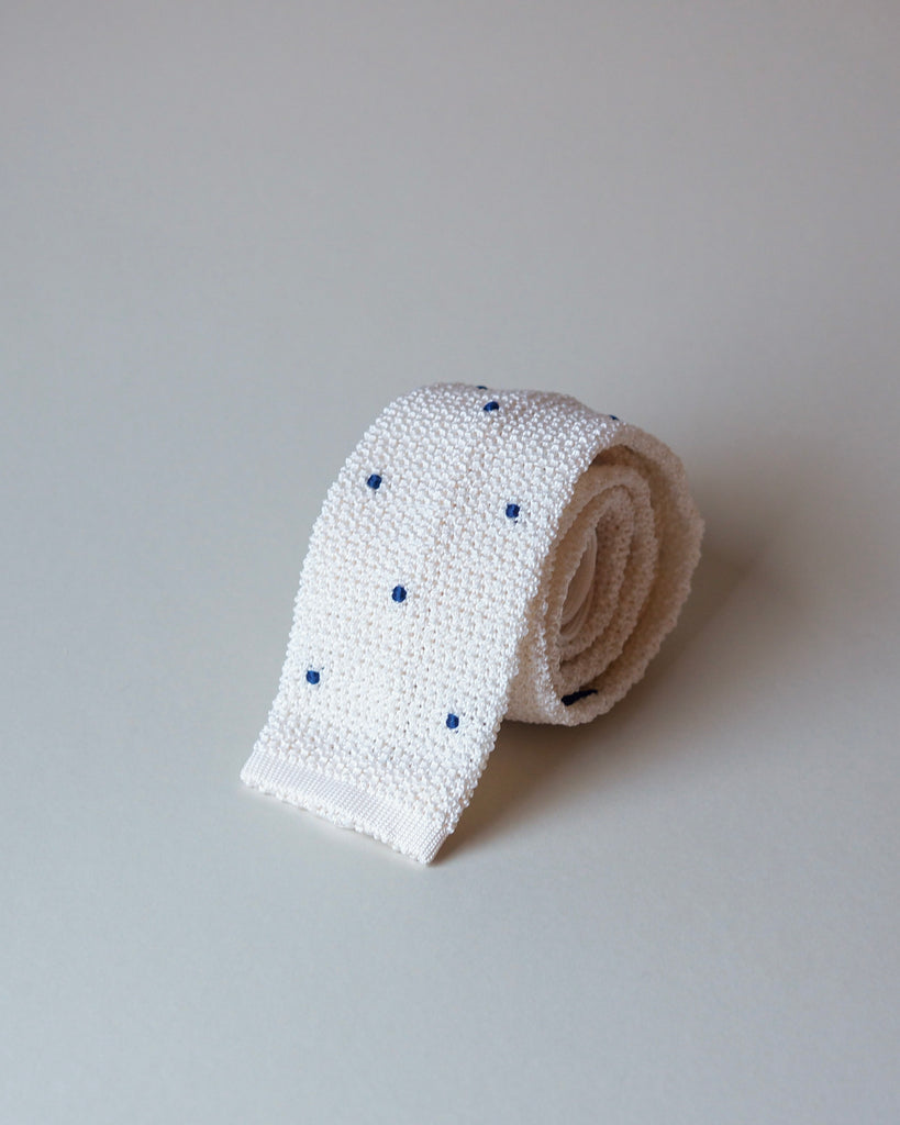 White knit tie with handsewn navy spots
