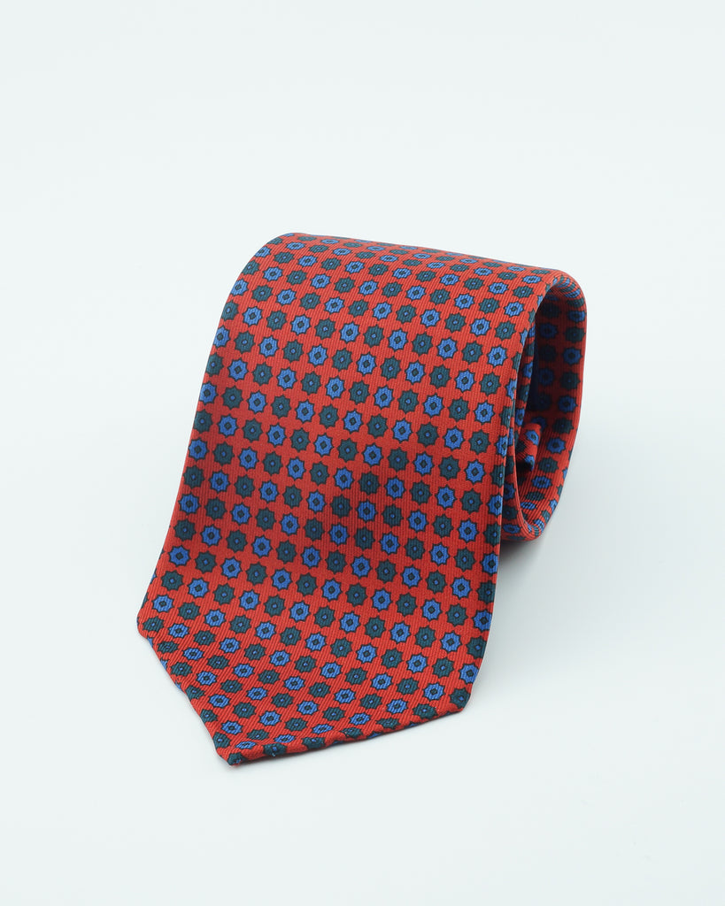 Red neat hand rolled madder tie