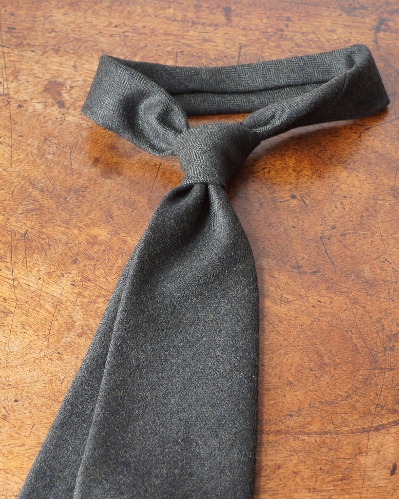 Dark green herringbone wool tie