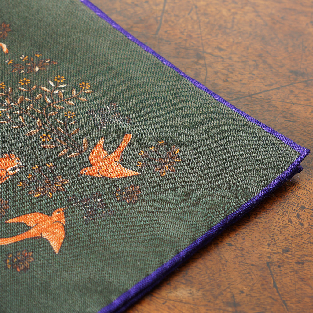 Dark green animal print wool/silk pocket square with purple border