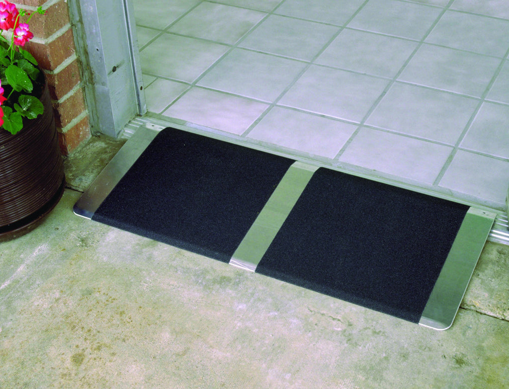 "32"" Wide Grooved aluminum adjustable threshold ramp 1"" to 2"" high."