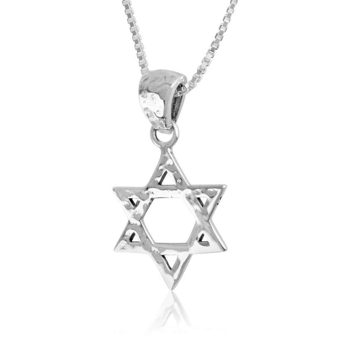 Hammered woven Star of David silver pendant. Handcrafted Star of David pendant made of silver with a unique hammered texture. The pendant with organically curved triangles interwoven to form the Star of David.