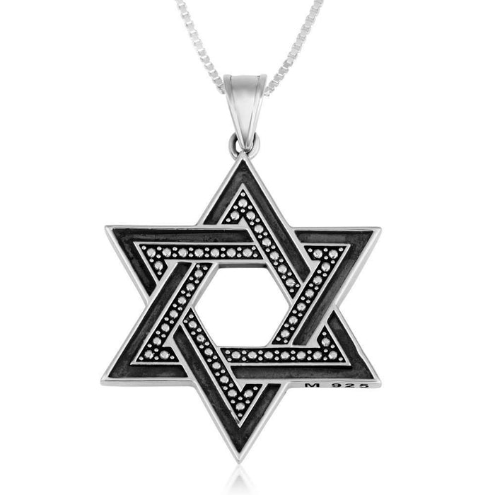 Star of David silver pendant comprised of two interwoven triangles dual layer. A large dual layer Star of David. One side is a flat blacken oxidized silver, while the other is diamond shaped artwork. A beautiful classic piece.