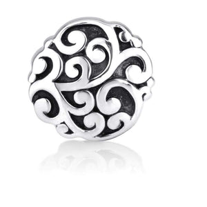 Round bead charm with raised shiny silver artwork on the blacken oxidized background. Oxidized silver maximizes the ancient talisman effects.
