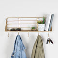 Stratton Home Decor Gold Metallic Metal Wall Shelf with Hooks