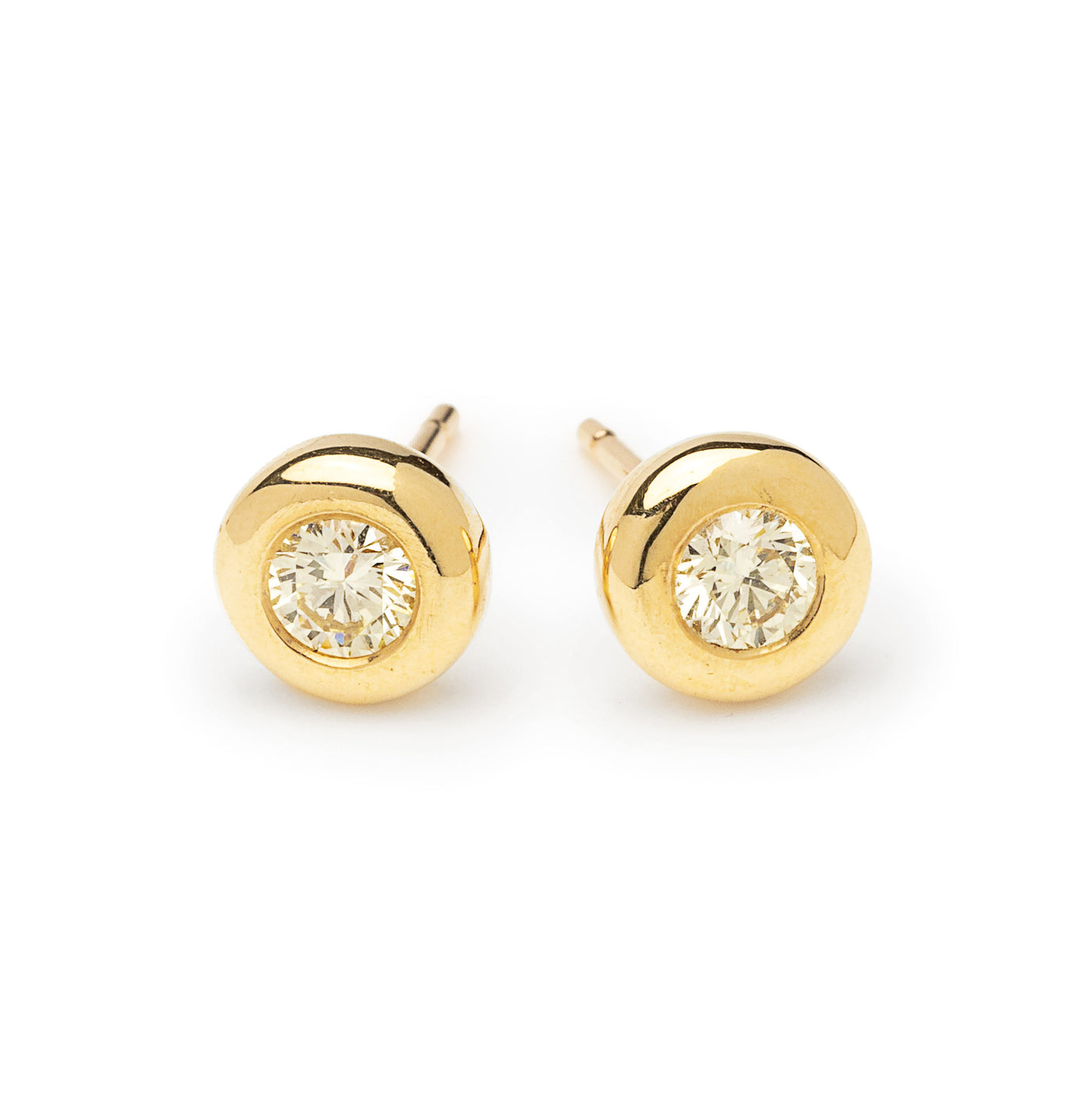 round diamond and gold studs