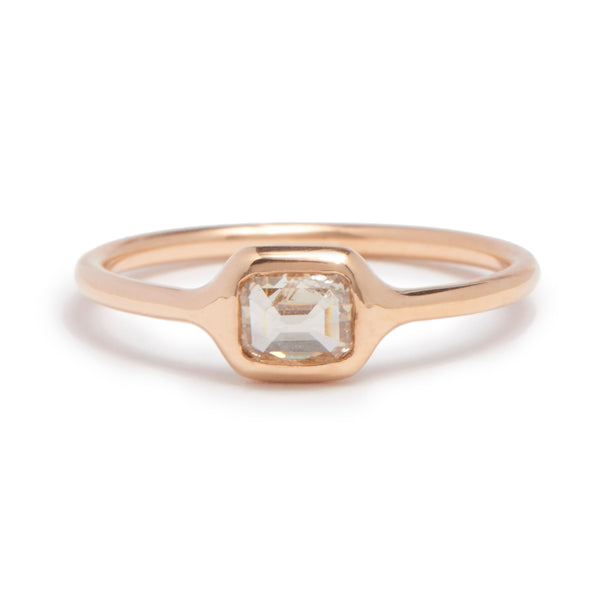 peachy emerald cut carved ring