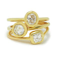 diamond solitaire rings set in 18k gold