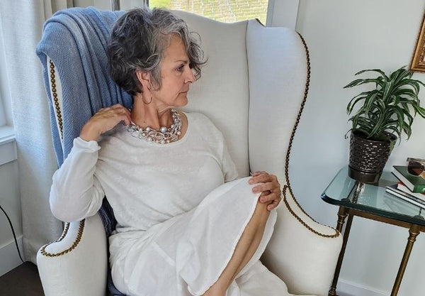 Silver and grey Swarovski crystal necklace on a woman in her fifties
