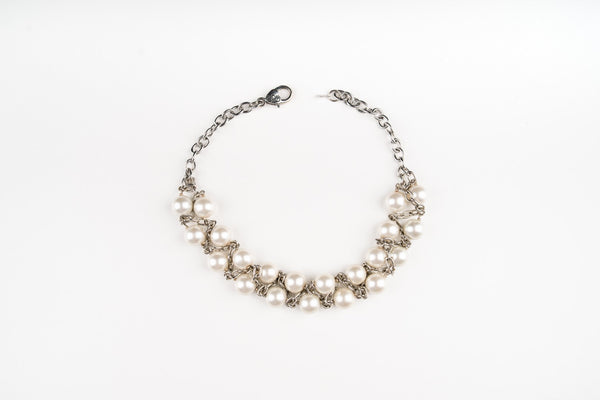 A buyer's guide to pearls- a Carolily Finery statement necklace made from white Swarovski crystal pearls
