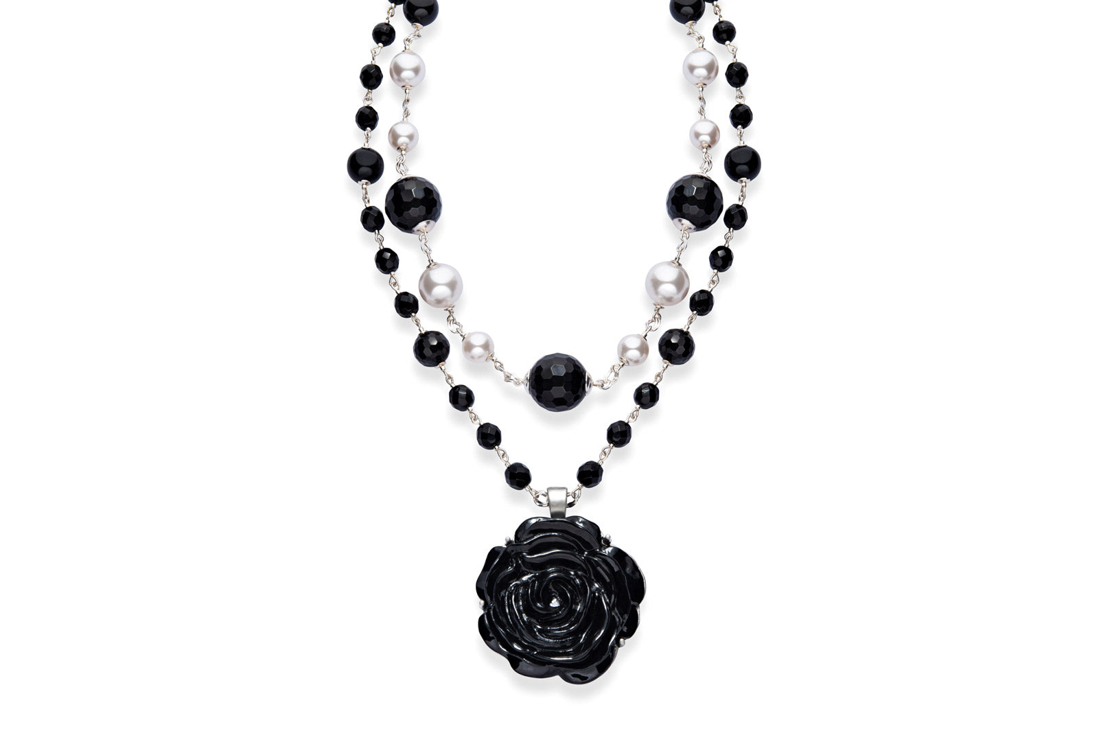 Statement necklace made from pearls, black onyx and a large black flower.