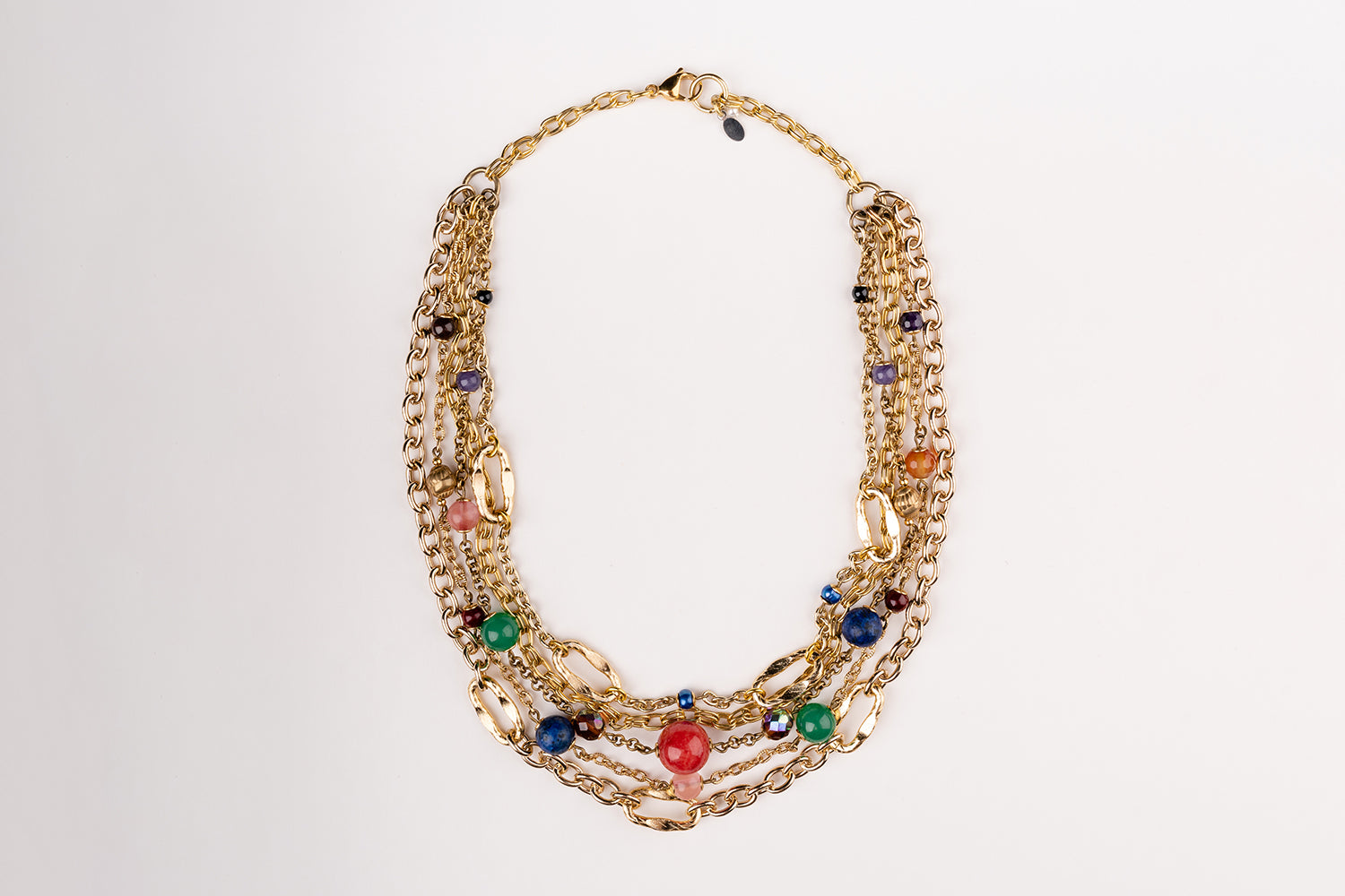 a Carolily Finery statement necklace made from gold plated chain, freshwater pearls and various gemstones