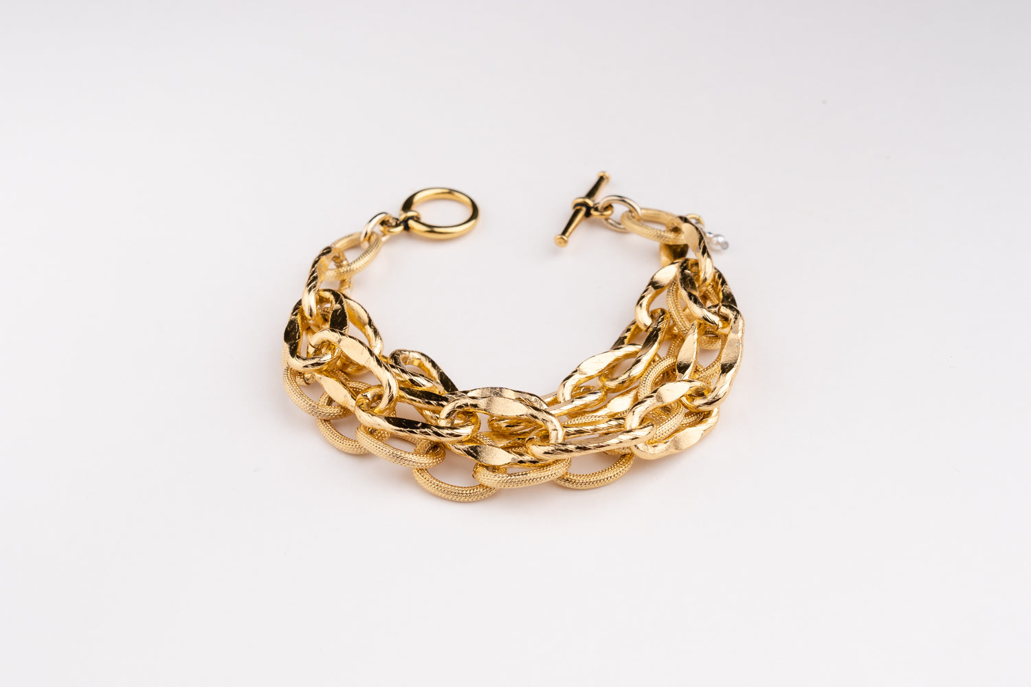a Carolily Finery bracelet made from various gold plated chains