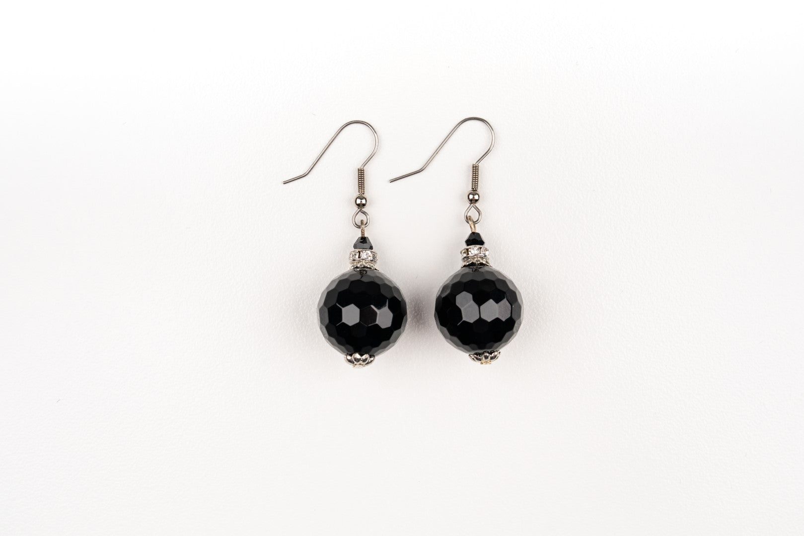 Carolily Finery earrings made from faceted onyx, and crystal rondelles