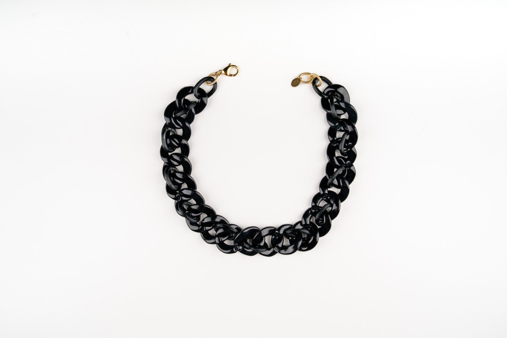 a Carolily Finery statement necklace made from black acrylic curb chain