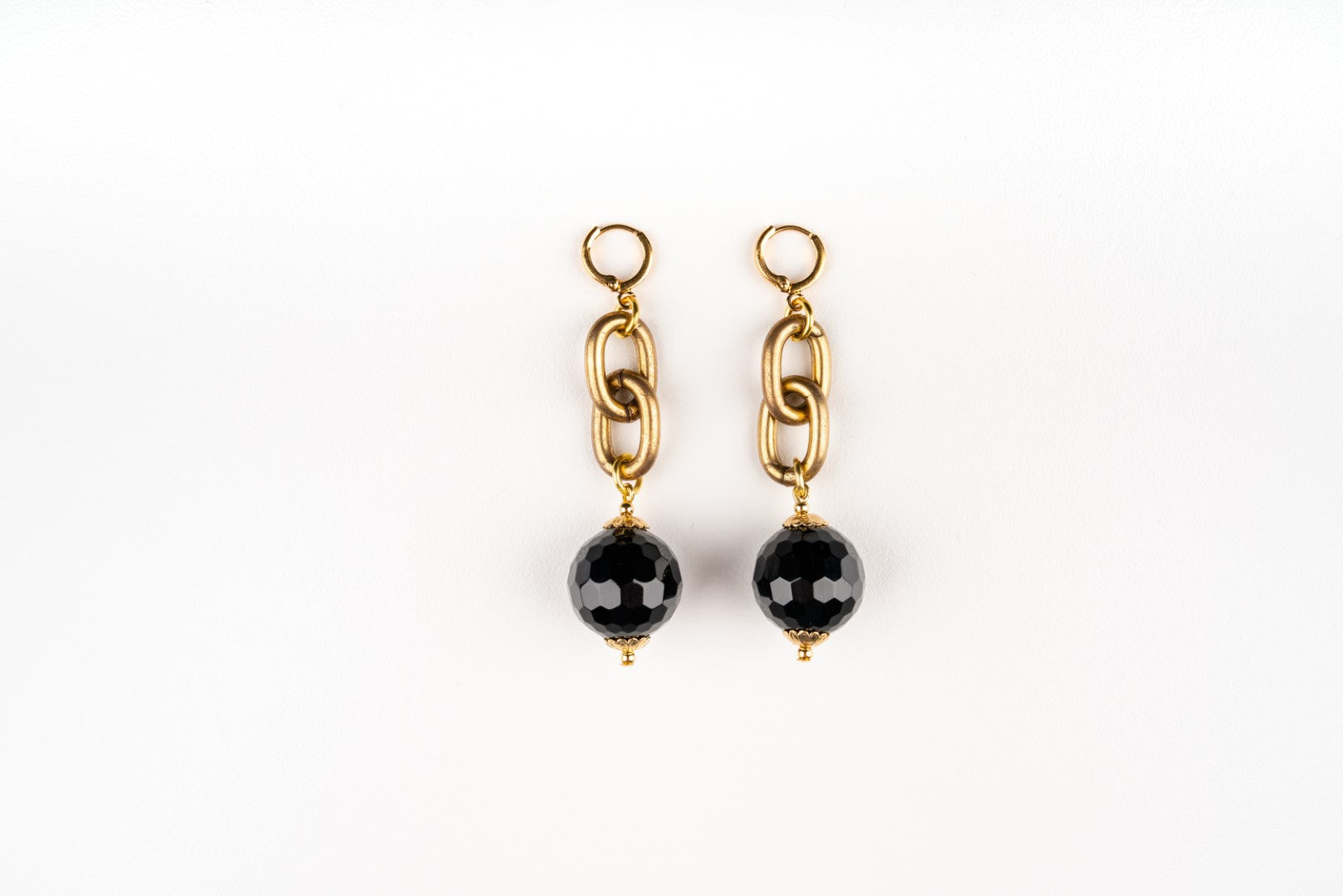 Carolily Finery earrings made from faceted black onyx, antique gold plated chain