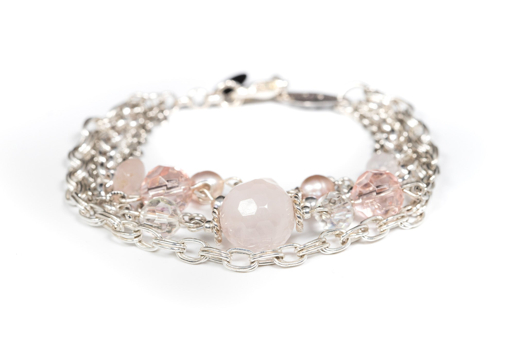 a Carolily Finery bracelet made from rose quartz and sterling silver