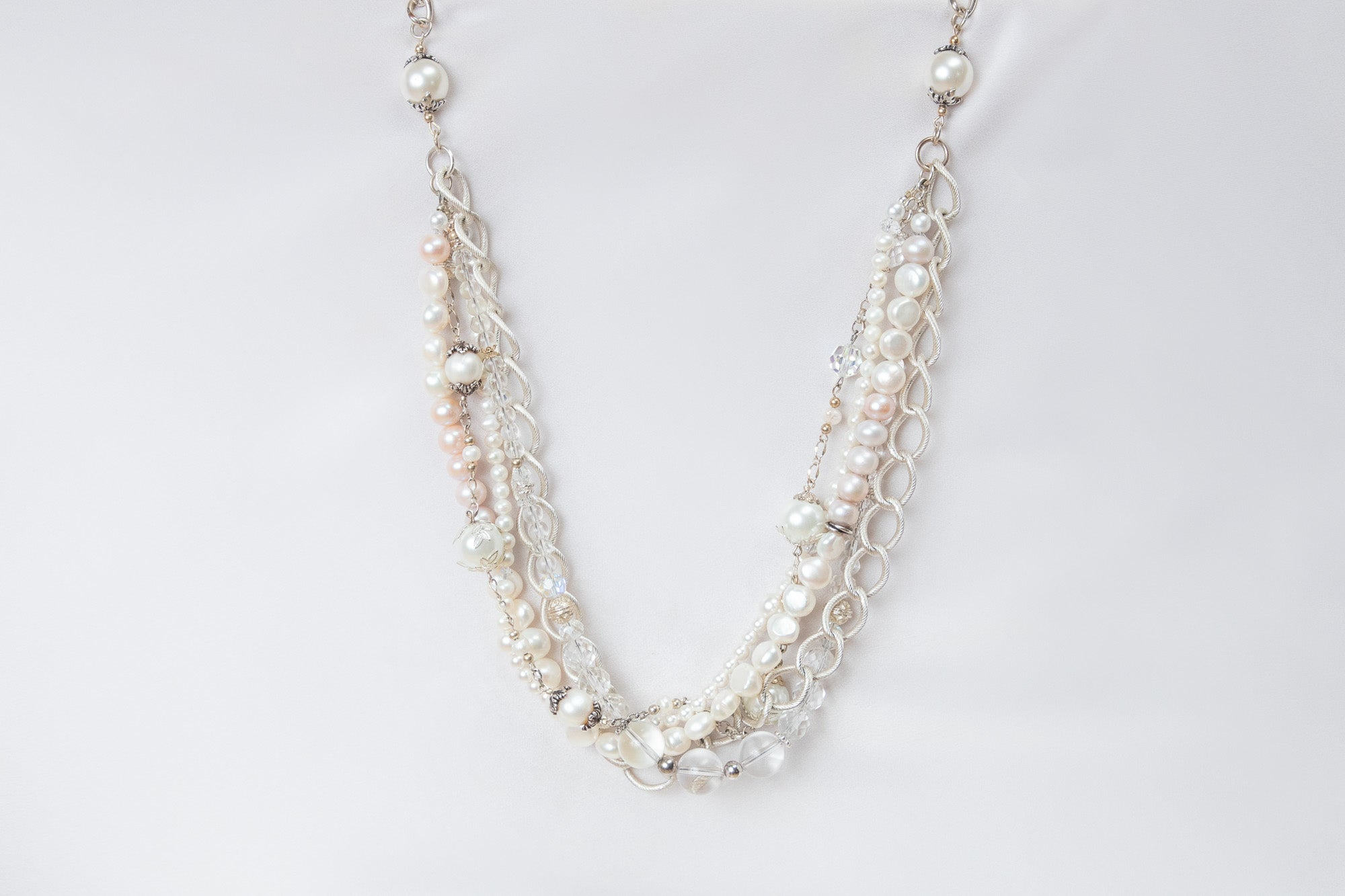 a Carolily Finery statement necklace made from genuine crystal quartz gemstones, freshwater pearls, sterling silver and Swarovski crystal pearls
