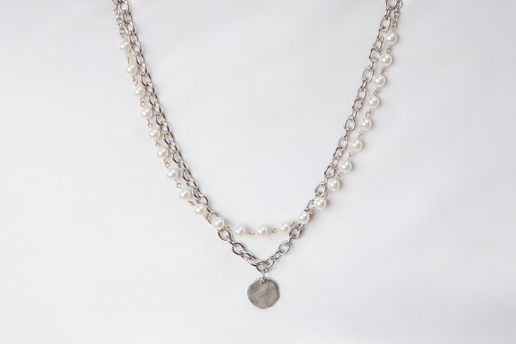 a Carolily Finery statement necklace made from Swarovski crystal pearls, stainless steel chain and a sterling silver coin