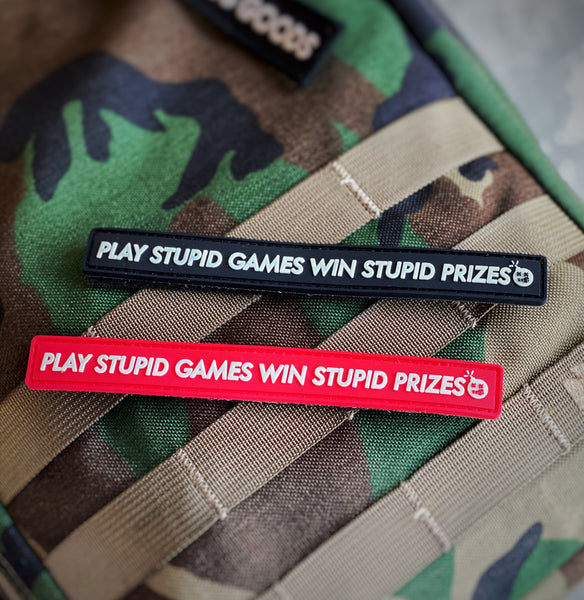 "Dangerous Goods™️ ""Play Stupid Games Win Stupid Prizes"" PVC Morale Patch - 2 Colors"