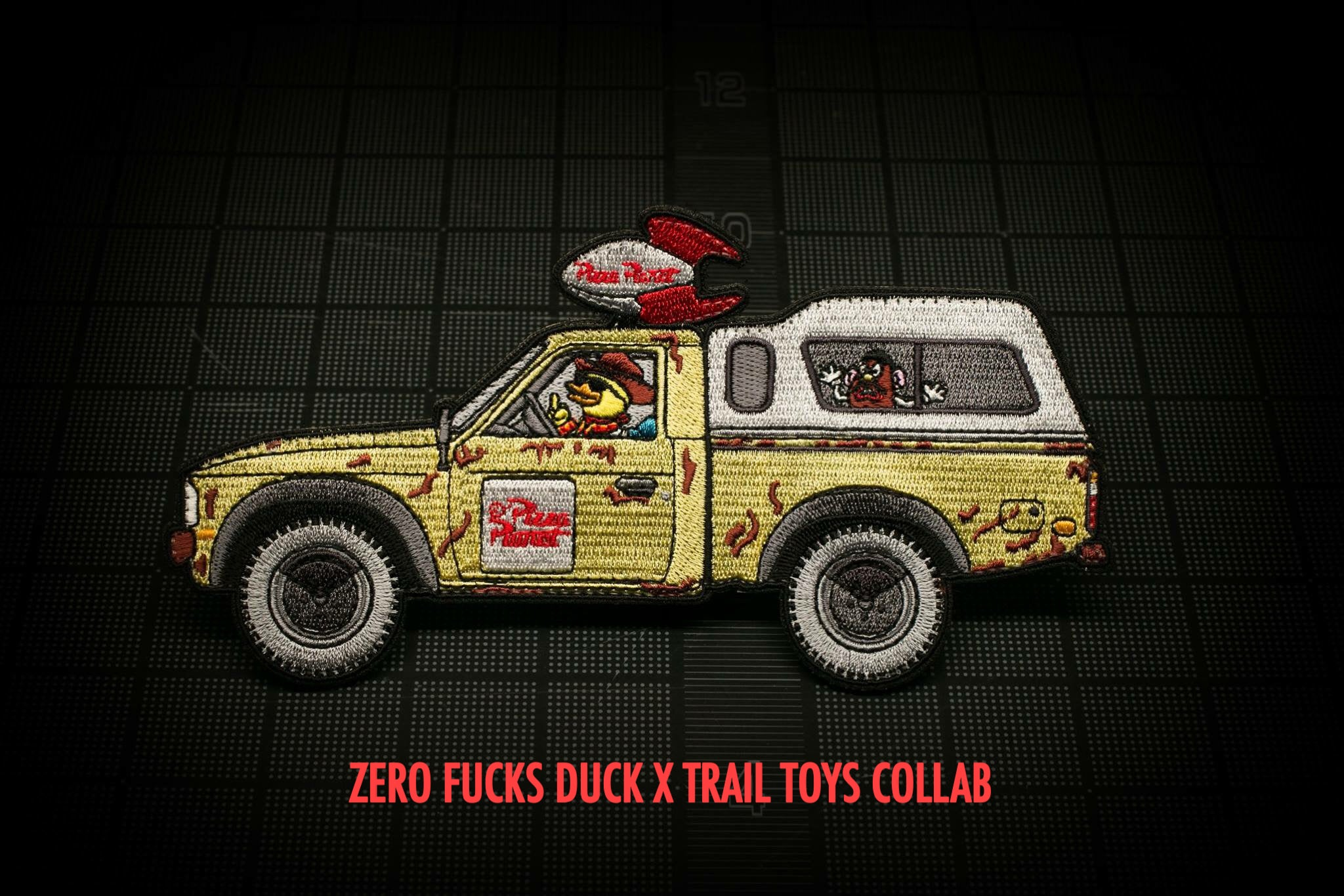 ZERO FUCKS DUCK x TRAIL TOYS PIZZA PLANET MORALE PATCH COLLAB