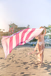 The Boca Grande Pink Striped Travel Towel - modeled with (Em)pire Style of Mind - blowing in the wind