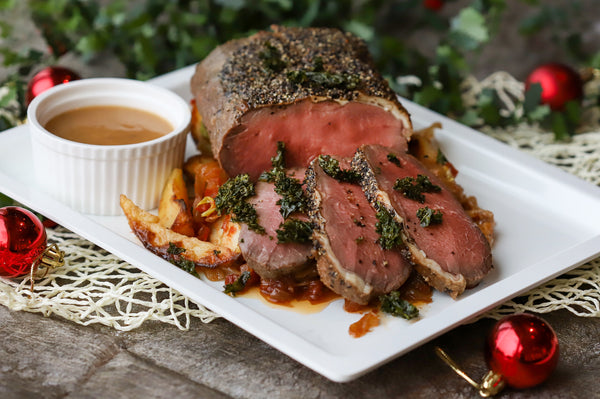 45. ROAST US GRAIN FED ANGUS BEEF STRIPLOIN WITH ROAST POTATO & CARAMELISED ONION, GREEN PEPPER SAUCE (SERVE 4-6 PAX)