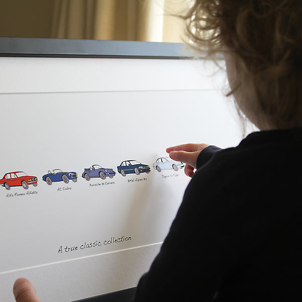 Car gift for dad. Pointing at artwork. Artwork includes persons car history. Maserati. Range Rover sport. Porsche Boxster S. Porsche panamera s. Jaguar s-type. pointing at an audi r8. Your life in cars framed artwork. child pointing at car artwork. Framed artwork, personalised car artwork, my life in cars gift, bespoke car gift, my first car, my life in cars