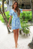 BLUE PEBBLES MINI RUFFLE WRAP DRESS
