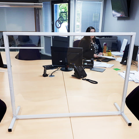 freestanding table top workstation divider in use