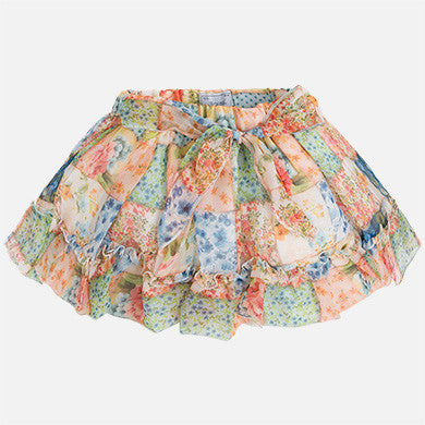 Girl short patchwork skirt with bow