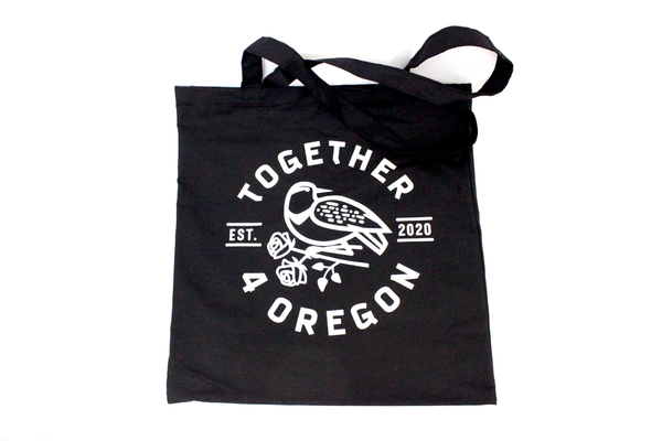 6oz black canvas with hand screen printed white design in partnership with Together 4 Oregon
