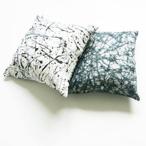 black and white splatter paint pillows