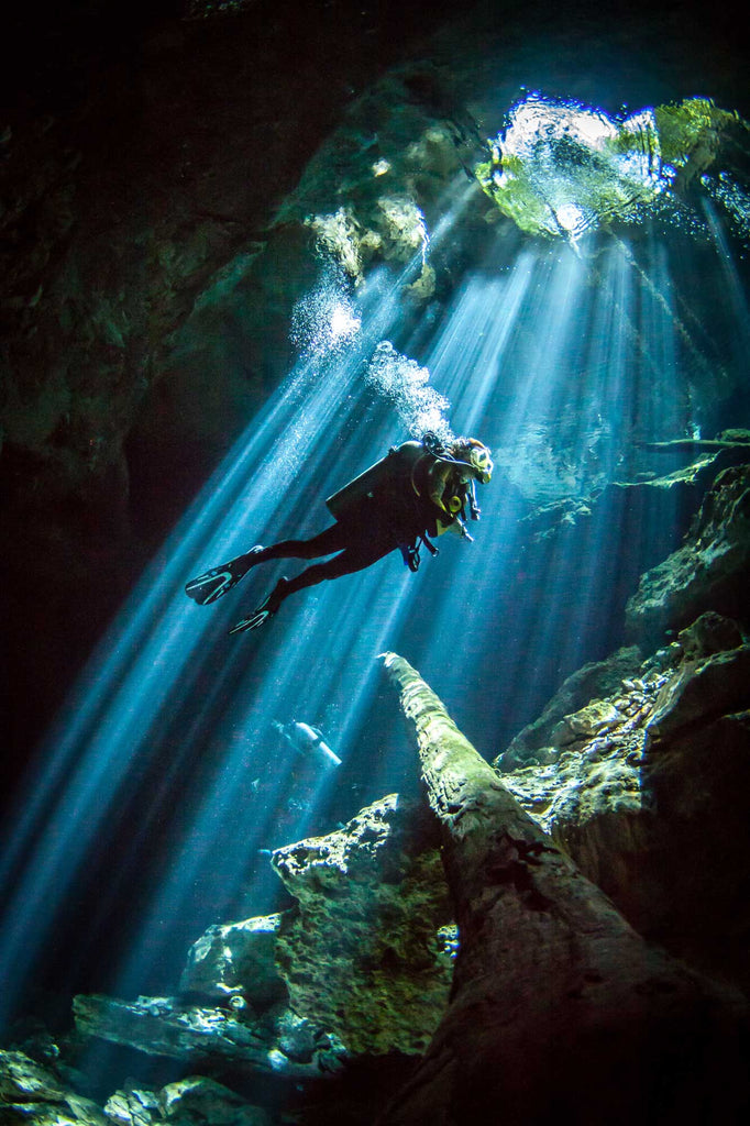 Cenote with streaming light rays by Steve Miller with Ikelite Housing