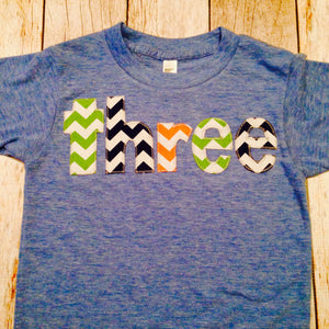 Birthday Shirt Athletic Blue Short Sleeves three in green, blue, yellow, red and orange letters