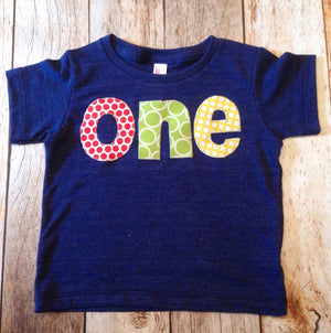 one for 1st Birthday Number pick ball dot circle primary red, yellow, grass green on triblend indigo primary colors navy boys